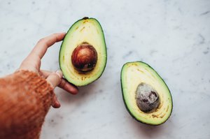 woman holding avocado in a natural health short course